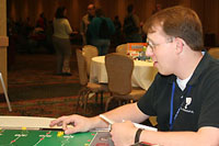 An image of Two men playing National Finger Football - Alabama and enjoying the fun of it at GAMA 2010