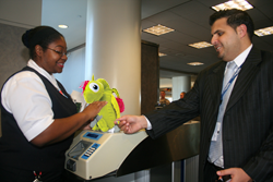 Image of some of Nora, one of the WorryWoos, checking in at the gate for a flight to Las Vegas.
