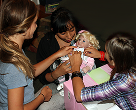 Image of some young girls playing with the Adora� Toddler Time - The Cat's Meow doll.