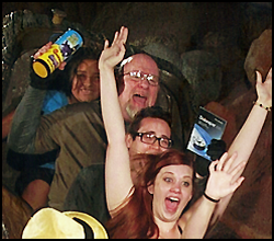 Image of The Toy Man on the Splash Mountain ride in Disneyland, holding Diception up in the air while flying down the water slope!