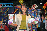 Image of woman at WTHRA trade show in Long Beach holding Moo: The Liberty Cow plush animal