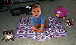 An image of the Oshi mat with infant in Play on it.