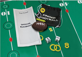 Picture of all of the pices and a portion of the playing field for Finger football